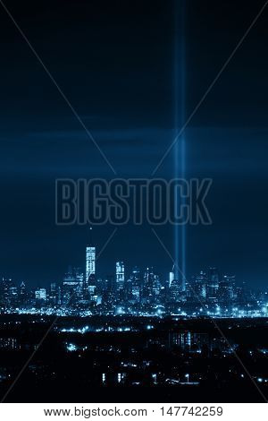 New York City skyline at night and September 11 tribute light