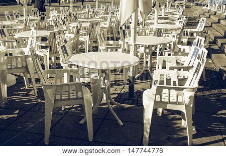Vintage looking Rows of chairs for outdoor dehors alfresco bar and live gig concert open air events