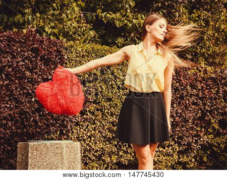 Girl Throwing Heart Into Dumpster.