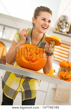 Smiling Housewife With A Big Orange Pumpkin Jack-o-lantern