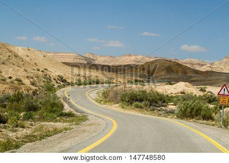 Road in Makhtesh Gadol or Large Crater, nature reserve in Negev desert, Israel