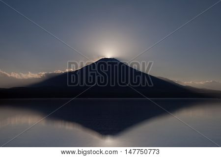 Fuji diamond Sunset on Top of Mountain Fuji and refection at Lake Yamanakako in autumn season