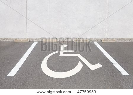 Empty outdoor car handicapped parking space area