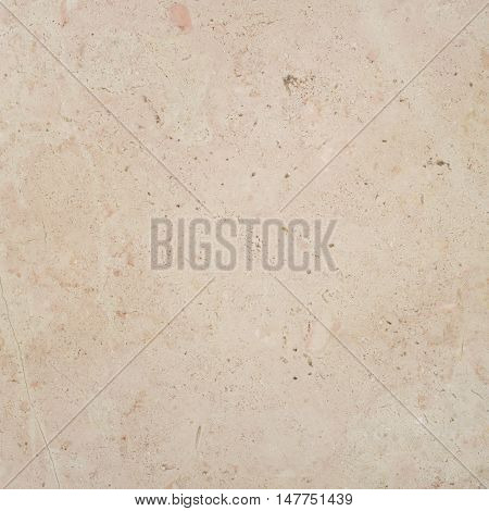 Beige light warm Trani Marble stone natural surface for bathroom or kitchen countertop. High resolution texture and pattern.
