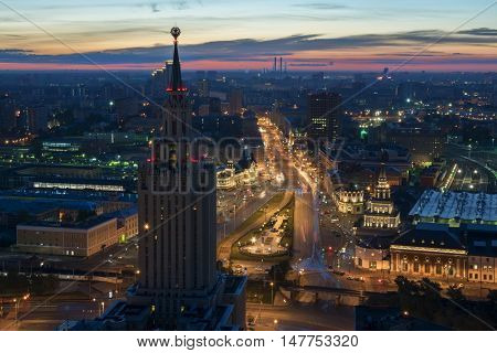Stalin skyscraper on Komsomolskaya square and city road at early morning in Moscow