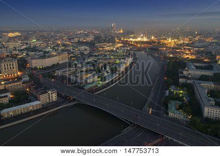 Big Stone Bridge, Moskva river, Kremlin with illumination in Moscow, Russia, view from Stalin skyscraper on Kotelnicheskaya quay