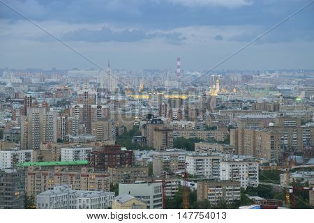 Many residential buildings and roofs at summer evening in Moscow, Russia
