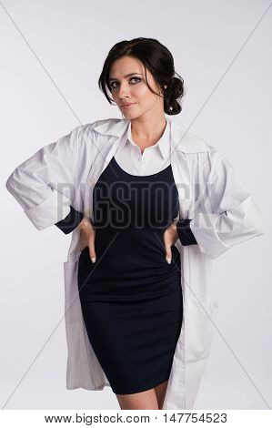 Sexy nurse in a dressing gown and dress. Isolated on white background.