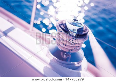 Sailboat winch and rope yacht detail. Yachting background theme.