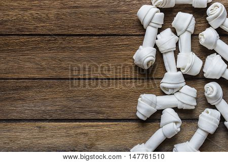 dog bone on old wooden table, background