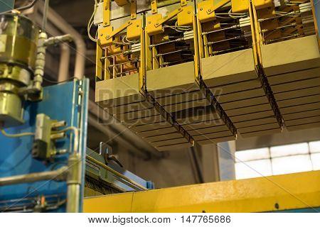 Brickyard. Photo of production machine with bricks