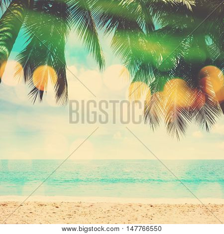Summer beach coconut palm trees with blue sky and turquoise sea vintage filter effect