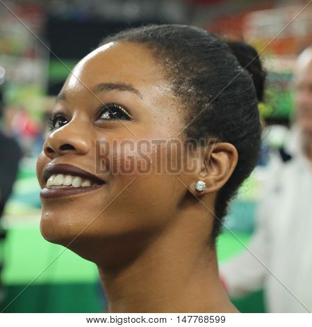 RIO DE JANEIRO, BRAZIL - AUGUST 9, 2016: Olympic champion Gabby Douglas of United States competing at team women's all-around gymnastics at Rio 2016 Olympic Games at Rio Olympic Arena