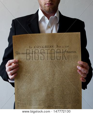 Declaration of Independence in the hands of a man in a jacket