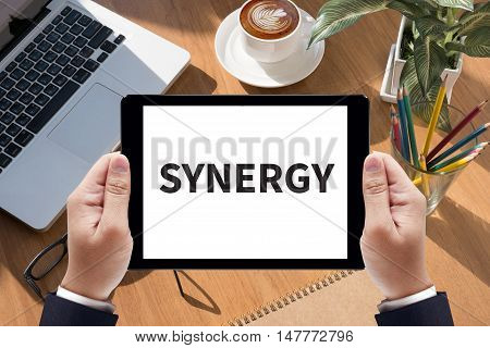 SYNERGY Businessman work on tablet on screen poster
