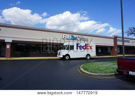 BOLINGBROOK, ILLINOIS / UNITED STATES - SEPTEMBER 17, 2016: A FedEx truck is parked outside of the FedEx Office at the Marketplace at Barber's Corner strip mall in Bolingbrook.
