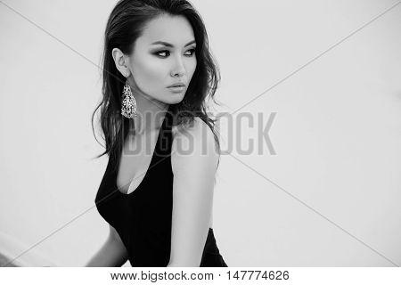 Professional photo shoot in desert. Beautiful sexy asian woman model in desert