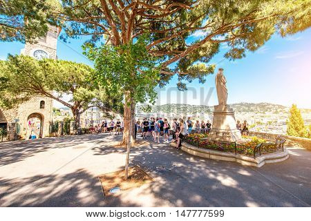 Cannes, France - June 14, 2016: Tourists near Castre museum on the squre with cityscape view on Cannes city on the french riviera