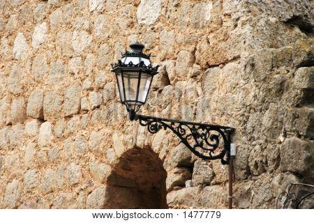 Lamp On An Old Wall
