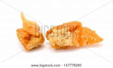 two crispy wontons on white background and it is a very popular snack in China