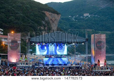 BUDVA- JULY 18 : CROWD IN FRONT OF THE DANCE PARADISO STAGE MORNING SESSION AT BEACH AT SEA DANCE FESTIVAL 2015 MUSIC FESTIVAL JULY 18 2015 IN BUDVA JAZ BEACH MONTENEGRO