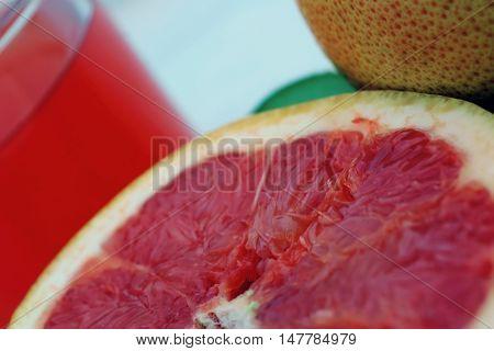 fresh fruits: orange kiwi and pomelo cuts on white background