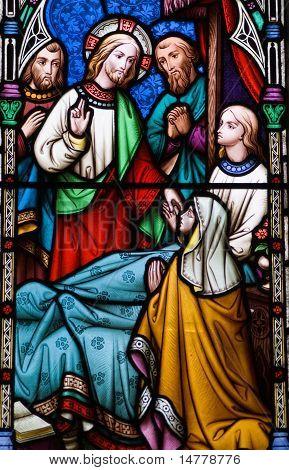 Jesus healing stained glass window