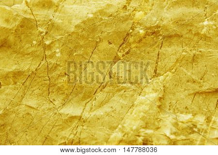 surface of the marble with gold tint