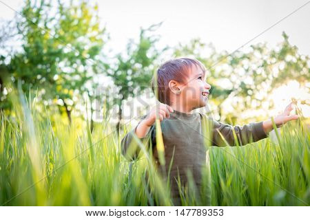 Happy kid on summer vacation having fun and happy life time