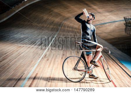 Drinking athlete on velodrome