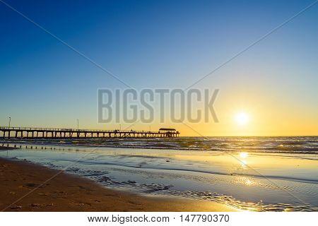 Henley Beach Jetty on a warm sunny evening.