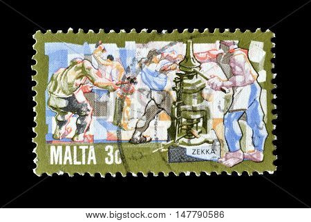 MALTA - CIRCA 1981 : Cancelled postage stamp printed by Malta, that shows Minting coins.