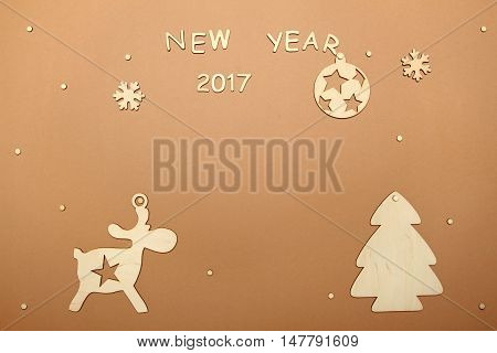 Christmas card with the text of the new year, wooden silhouettes of trees, reindeer and Christmas tree ball