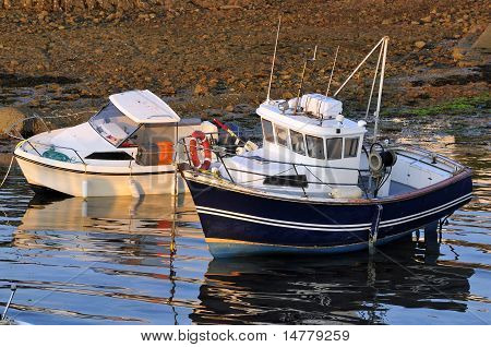 Two boats in a port of Brittany