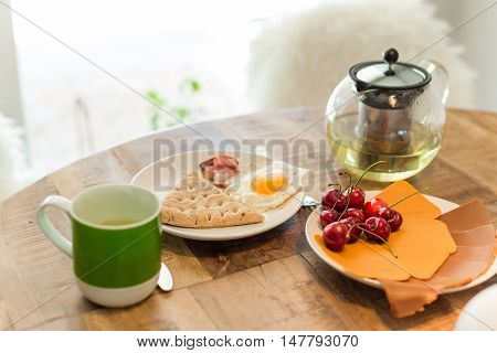 fresh breakfast with bread cheese cherry and tea