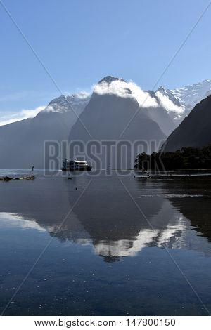 Milford Sound and Mitre Peak in Fiordland New Zealand water reflection. 8th wonder of the world.