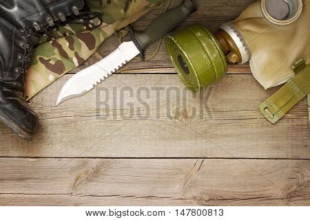 Military accessories on wooden boards abstract background