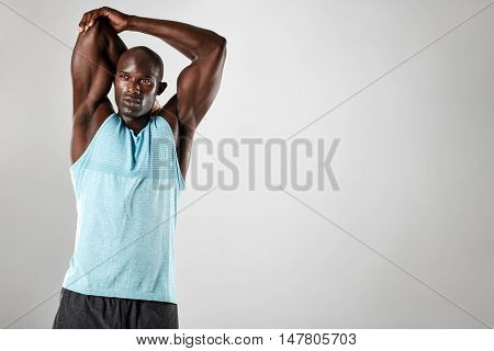 Strong Young Muscular Man Stretching His Arms