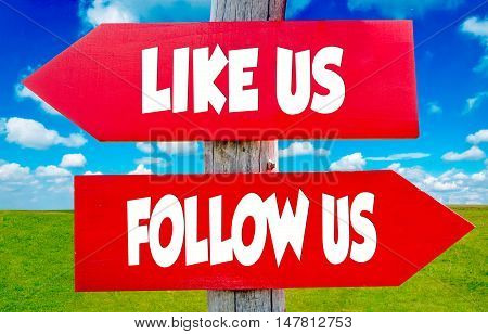 Follow us and like us on the red signs with landscape in background