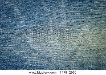 Closeup denim jeans texture. Stitched textured blue denim jeans background. Old grunge vintage denim jeans. Denim jeans with old torn of fashion jeans design.