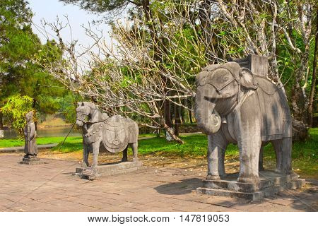 Stone statues of horse, elephant and man in Imperial Minh Mang Tomb of the Nguygen dynasty in Hue, Vietnam. UNESCO world heritage site
