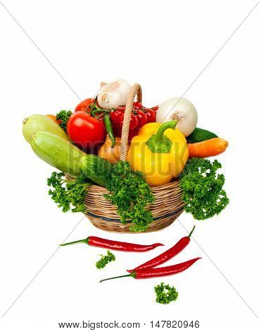 vegetables in a wicker basket on a white background