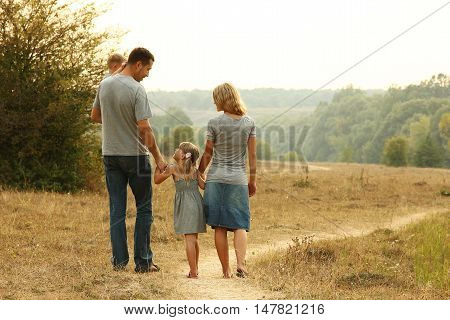 a happy young family on the nature