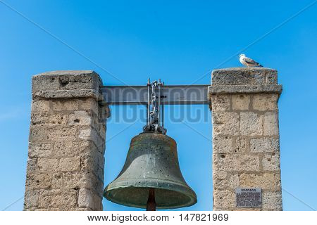 Bell from Notre Dame de Paris isolated on white. Now situated in Chersonese, Ukraine, Sevastopol