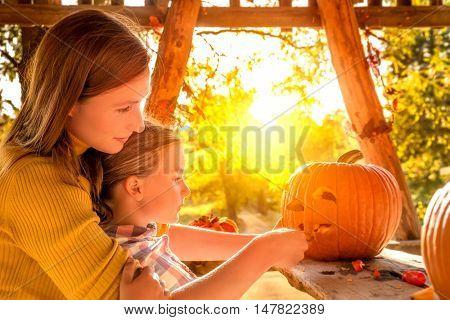mother helping daughter preparing for hallowe'en