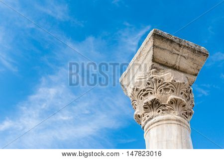 The column in the Ancient city Chersonese, on a bluesky background. Ruins of Basilica 1935 VI-X c. , Sevastopol, Crimea Russia. Free space for text.