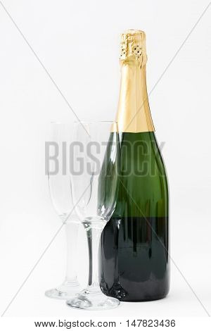 Champagne bottle with glass cups isolated on white background