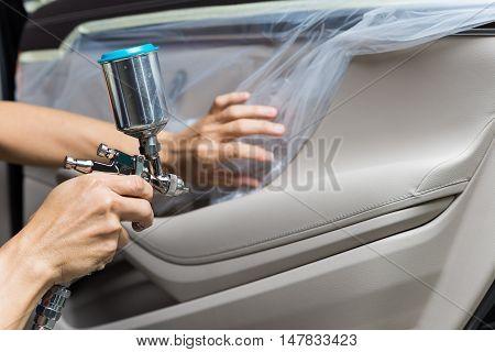 Car detailing series : Closeup of hand coating luxury car door panel