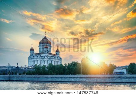 Moscow landscape - Cathedral of Christ the Saviour in summer sunny evening in Moscow Russia. Moscow sunset view. Sunset view of Moscow architecture landmark. Moscow architecture view.