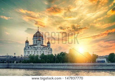 Moscow landscape - Cathedral of Christ the Saviour in summer colorful sunset in Moscow Russia. Moscow sunset view. Summer view of Moscow architecture landmark. Moscow architecture view.